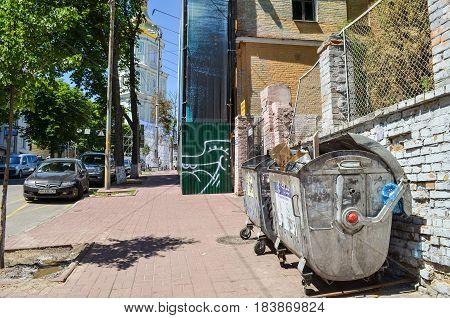 Kiev Ukraine - May 25 2013: Dirty dumpster with trash on street in downtown on sidewalk