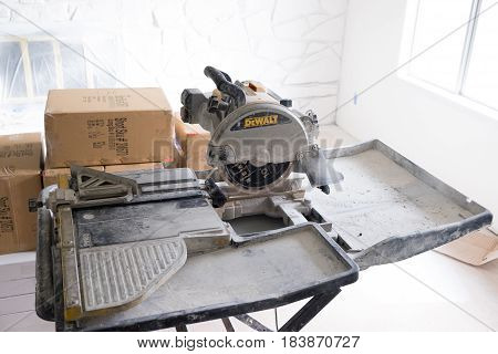 SPRINGFIELD, OR - JANUARY 20, 2017: DeWalt tile saw setup and ready to cut during a DIY house remodel and renovation project.