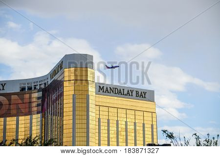 Las Vegas USA - May 7 2014: Mandalay Bay building exterior on strip with airplane