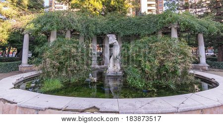 water fountain with sculpture Jardines del Real - Viveros Valencia, near old dry riverbed of the River Turia