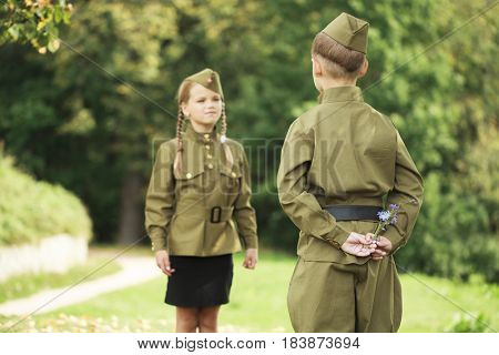 Long-awaited meeting. Two children in military uniforms of the Great Patriotic War. World War II