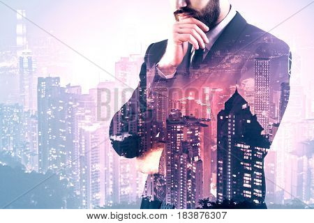 Side view of thoughtful young man on abstract city background with copy space. Employment concept. Double exposure
