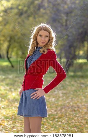 Beautiful girl in the autumn park in a sunny day