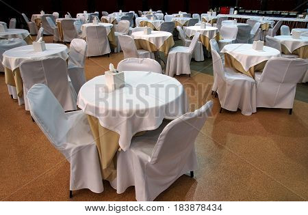 White tables in an empty restaurant in anticipation of visitors