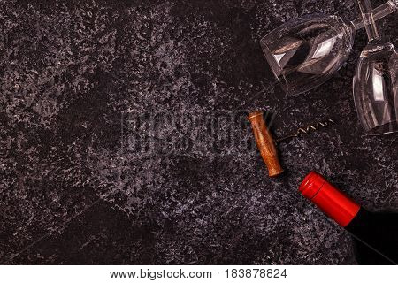 Wine, Glasses, Grapes And Corkscrew Over Stone Background.
