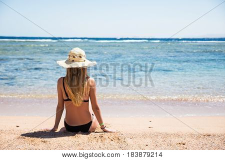 Woman On Beach Sitting In Sand Looking At Ocean Enjoying Sun And Summer Travel Holidays Vacation Get