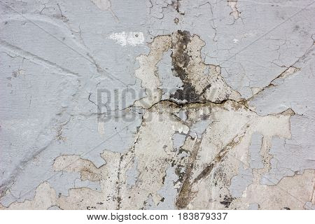 Wheathered Concrete Wall With Great Number Of Cracks