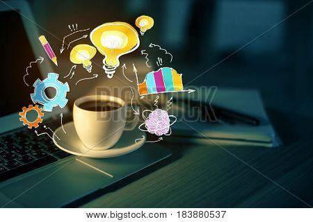 Close up of workplace with laptop coffee cup and abstract business sketch. Idea concept