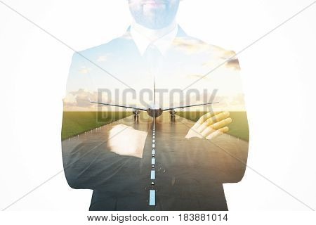 Businessman on abstract background with takin off airplane. Business trip concept. Double exposure