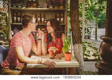 Young Beautiful Happy Loving Couple Sitting At Street Open-air Cafe Holding Hands Looking At Each Ot