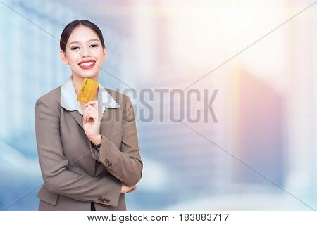 business woman with credit card. Double exposure photo of panoramic city
