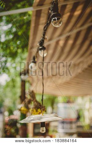 Decoration, Outdoor Retro Vintage String Lights Hanging In A Line. Lighting Decor.
