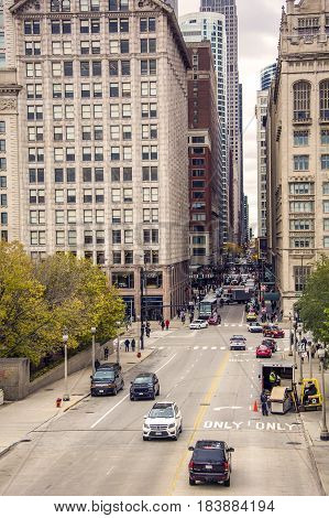 Chicago IL USA october 2016: Monroe street crossing Michigan avenue with traffic. Viewed from Nichols bridgeway in Chicago