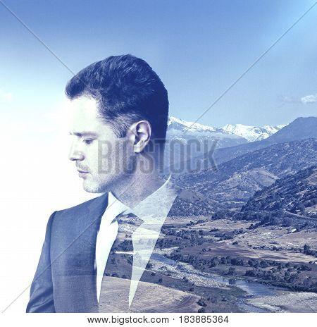 Side portrait of young european man on landscape background. Double exposure