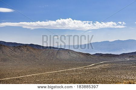 panoramin view of Panamint Valley desert with small road