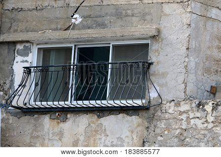 Windows like human eyes, always look at us when we walk along the street