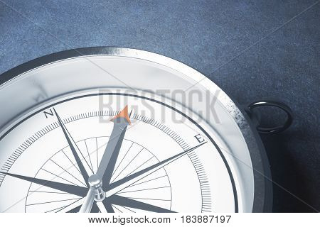Close up of silver compass on light surface. Orientation concept. 3D Rendering