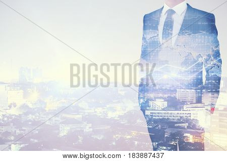 Businessman on abstract city backgroud with copy space and forex chart. Business concept. Double exposure
