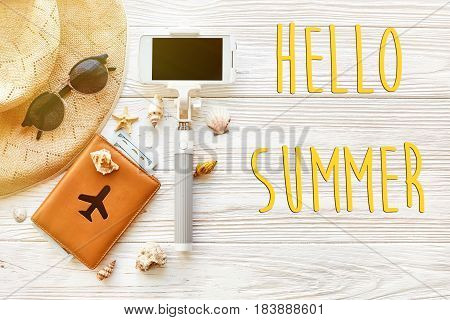 Hello Summer Text, Travel Vacation Concept Flat Lay, Space For Text. Selfie Stick Phone Camera Passp