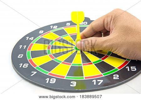 Setting goal or accurate planning hand going to take dart into the center of dartboard