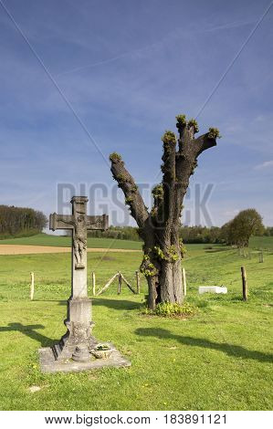 Wayside cross near Terborgh castle in the Dutch village Schinnen in the most southern province Limburg
