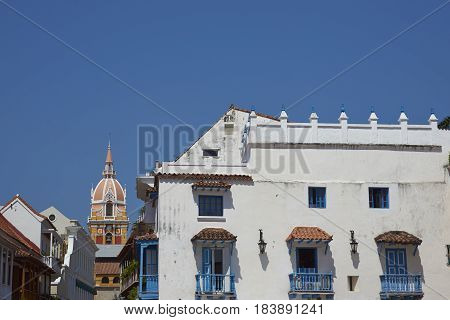 Stone tower of the historic Cathedral of Saint Catherine of Alexandria rising above the rooftops of the Spanish colonial city of Cartagena de Indias, Colombia.
