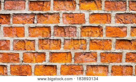 Textured old orange rick wall with horizontal lines