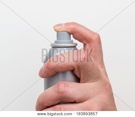 Spraying deodorant isolated on a white background