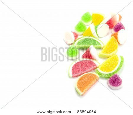 candies. jelly candies in plate on a background. jelly candies on white background.