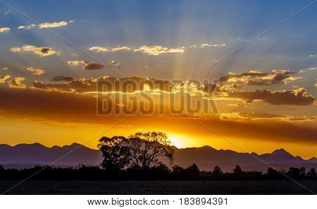 A beautiful golden sunset with mountains in the background