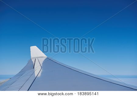 Airplane Wing  On Blue Sky Background