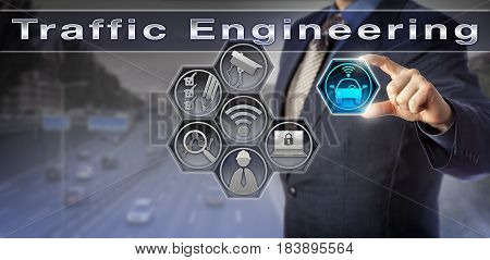 Blue chip civil engineer is researching Traffic Engineering via a virtual control matrix. Technology and industry concept for safe and efficient traffic flow urban planning and highway engineering.
