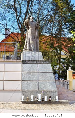 Bialystok Poland - April 29 2012: Bronze monument to pontiff Roman Pope on granite pedestal - religious memorial and place of worship near Cathedral Basilica of Assumption of Blessed Virgin Mary