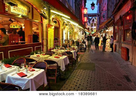 Restaurants and bars on evening streets of Brussels, Belgium.