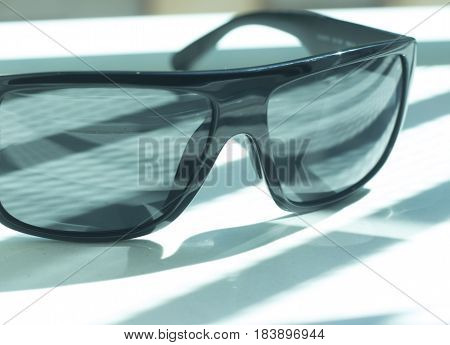 Men's fashion sunglasses. Dark tinted UV protection glasses used to protect the eyes from the sun.