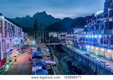 Tangkou China December 24 2016: Evening view of the buildings by Huangshan National park.