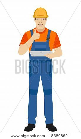 Builder holding digital tablet and showing thumb up. Full length portrait of builder character in a flat style. Vector illustration.