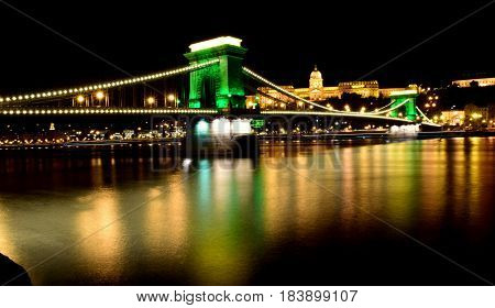 Night view of the Chain Bridge and Buda Castle by the Danube River, Budapest. Hungary
