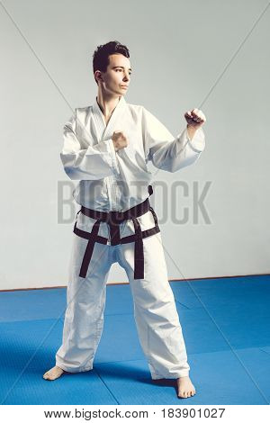 Girl, Taekwondo Is Martial Stoke Hands In Fists, Focused, Serious Look In The Studio On Gray Isolate