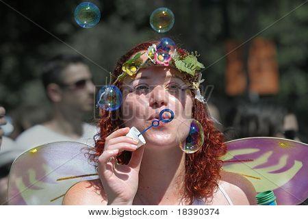 TEL AVIV - JUNE 12 : An unidentified participant blows bubbles at Annual Gay Pride Parade June 12, 2009 in Tel-Aviv.