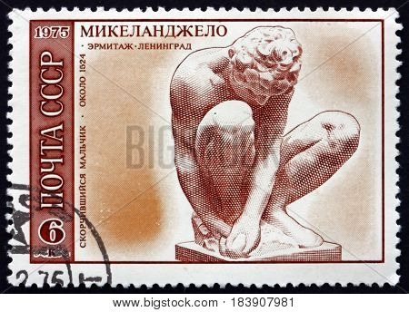 RUSSIA - CIRCA 1975: a stamp printed in Russia shows Squatting Boy Sculpture by Michelangelo Italian Sculptor Painter and Architect circa 1975