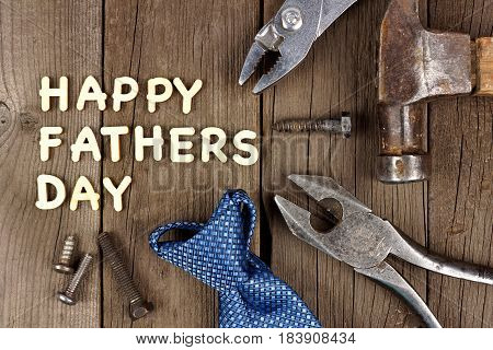Happy Fathers Day Wood Letter Greeting With Tools And Tie On A Wooden Background