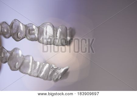 Denture invisible teeth aligner. No people. Plastic material