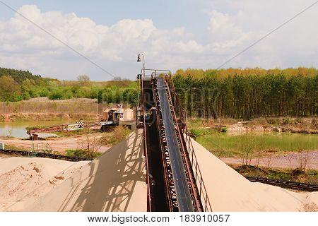 Conveyor Belts And Sand Heaps. Construction Industry. Sand Quarry, Heavy Duty Machinery. Horizontal