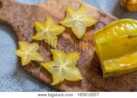 Star fruit, starfruit, carambola on wooden board background