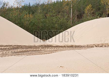 Sand heaps. Construction industry. Sand quarry. Horizontal photo.