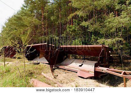 Abandoned Industrial Parts. Rusty Metall Equipment. Parts Of Quarry Crane.