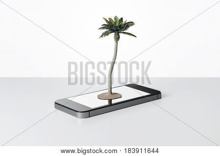 Toy palm tree on a smart phone with white background