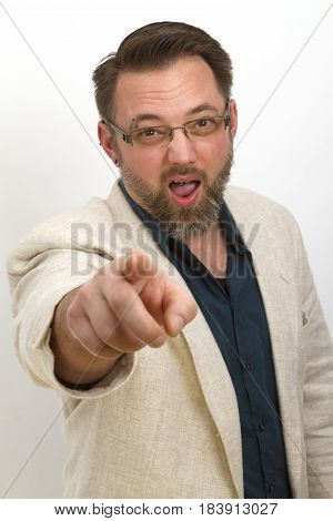 Bearded man is calling and gestures with his finger - on bright background