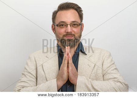 Young businessman meditates in lunchtime - on bright background
